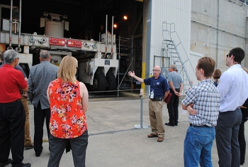 Savannah River Remediation Acting Director of Public Affairs and Project Communications Dean Campbell leads the fire protection engineers on a tour of the Defense Waste Processing Facility at the Savannah River Site.