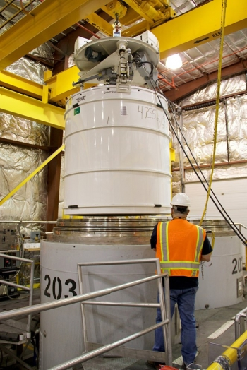 A Fluor Idaho employee loads a container with 10 55-gallon drums inside a TRUPACT-II shipping vessel at the Advanced Mixed Waste Treatment Project.