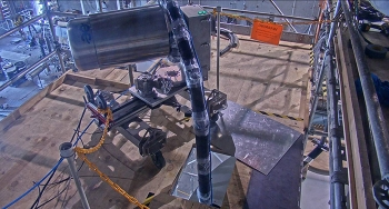 The robotic snake arm uses compressed air to move simulated high-level waste called calcine during a mockup demonstration.