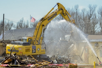 Crews demolished the C-212 office building.