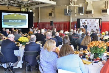 Employees, state legislators, stakeholders, local representatives, congressional staff members, and signatory and consulting party members attend a luncheon and preview of the K-25 History Center. Afterward, the attendees viewed plans for the facility.
