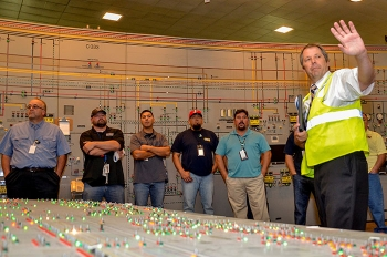 EM Paducah Site Safety Systems Oversight/General Engineer Brad Pont leads Atomic Energy Workers Council members through the C-300 Building.