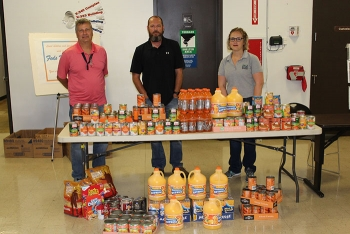 Left to right, the Portsmouth Site's Bryan Davis and Robert Henry, and contractor Restoration Services Inc.'s Abigail Parish take part in a Portsmouth/Paducah Project Office contest for the 2017 Feds Feed Families food drive.