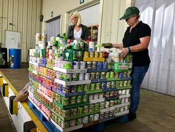 Portsmouth/Paducah Project Office's Paula Rhea (right) and Kearney Ackermann of contractor Mid-America Conversion Services top off a load of Lexington's donations for the 2017 Feds Feed Families food drive.