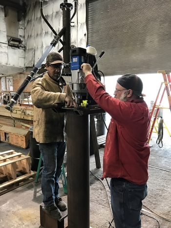 Workers at Diversified Metal Products, an Idaho Falls, Idaho-based small business, develop bin mockups to support Fluor Idaho's Calcine Retrieval Project.