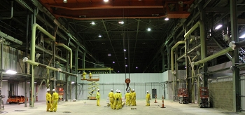 Geiger Brothers, a Historically Underutilized Business Zone small business, supports Portsmouth Site deactivation activities in a large process building housing uranium enrichment equipment. Here, Geiger crews work in the site's X-333 Process Building.