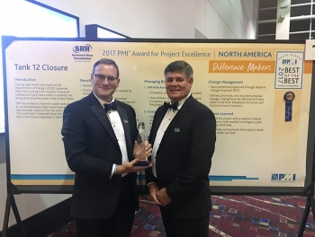 Savannah River Remediation (SRR) Chief Operating Officer Mark Schmitz, left, and SRR President and Project Manager Tom Foster accept the Award for Project Excellence at the Project Management Institute's Global Project Management Conference in Chicago.