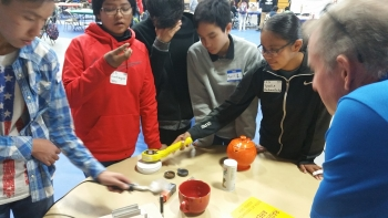 Students survey everyday objects to determine if they are radioactive.