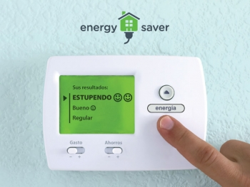 Photo of a digital thermostat with a hand adjusting the temperature.