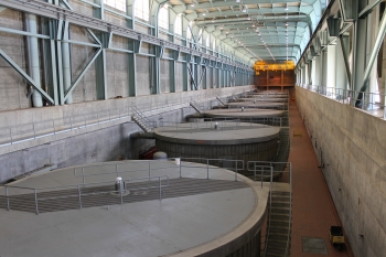 Photograph of hydroelectric generators in a row inside the dam
