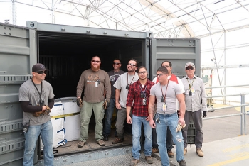 Team members celebrated the final shipment of RNS drums to WCRRF.