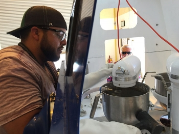 For several months, technicians practiced and refined the treatment method using a mock-up glovebox closely resembling the glovebox used during the actual treatment.