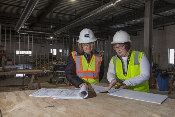 NNSA's Laurie Folden and Pam Gorman study blueprints on a job site at Y-12 National Security Complex