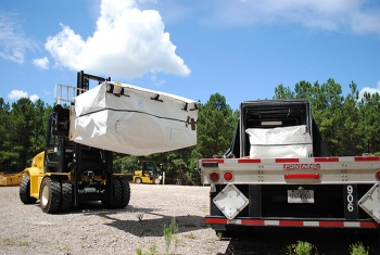Workers load a container of lead from legacy missions at the Savannah River Site onto a truck to transport to a waste disposal site in Texas.