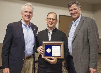 Accelerated Retrieval Project IX Federal Project Director Nolan Jensen, center, receives the EM Federal Project Director of the Year Award at the 2017 Contract, Project and Program Management Workshop.