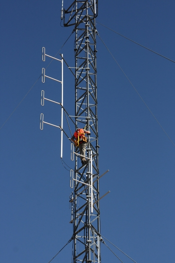 A worker inspects a tower on the 100-foot Gable Mountain East Telecommunications Tower on the Hanford Site.