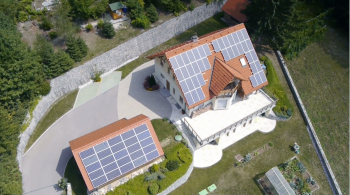 aerial rendering of home and garage with solar