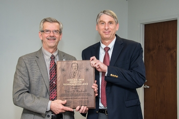 Savannah River National Laboratory Director Dr. Terry A. Michalske (left) awards Tracy S. Rudisill the 2017 the Donald Orth Lifetime Achievement Award, the highest honor given by the laboratory for technical excellence and leadership.