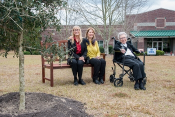 To commemorate Dr. Donald Orth's contributions to SRS, a tree and bench have been placed on the grounds of the Savannah River Research Campus, near Aiken, S.C. The memorial was given by daughters Claudia (left) and Donna (middle), and wife Jean (right).