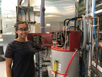 Woman next to a residential water heater
