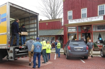 Volunteers from the West Valley Demonstration Project (WVDP) unload a pallet containing more than 200 bags of food for the Saving Grace OutReach Food Pantry in Cattaraugus, N.Y.