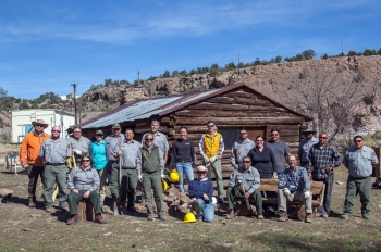 Participants at an NPS preservation workshop take a break from their work on the Pond Cabin, part of MAPR in Los Alamos, New Mexico.