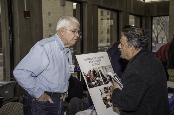 A visitor speaks with a STEM organization at the STEM Volunteer Fair.