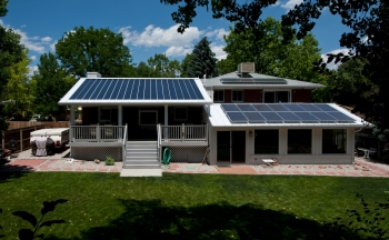 Home with multiple solar technologies, including daylighting, passive solar, active solar, and two kinds of PV.