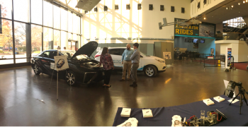 Two fuel cell electric vehicles on display inside the Smithsonian National Air and Space Museum