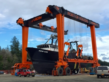 A boat is lifted in the high-capacity lift.