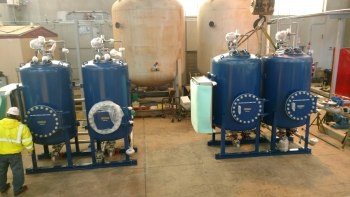 Multimedia filter and ion-exchange treatment skids at the Fernald Preserve CAWWT facility.