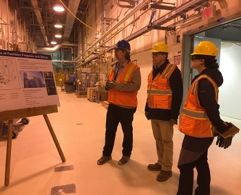 Under Secretary Paul Dabbar, (middle) and Chief of Staff Kristen Ellis (right) are briefed by Office of River Protection Assistant Manager for the WTP Bill Hamel at the WTP Analytical Laboratory.