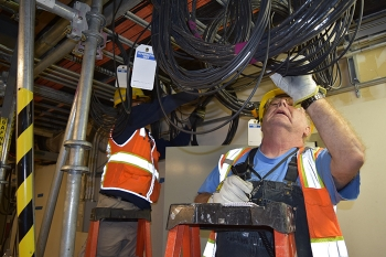 Hanford Waste Treatment and Immobilization Plant electricians install wiring inside the Low-Activity Waste facility.