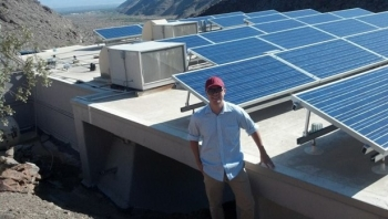 Photo of Dr. Tommy Jones by a photovoltaic array