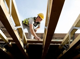 Photo of a man working on a house. Figure 1: Photo Courtesy of Meritage Homes.
