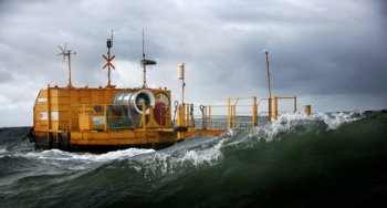 A yellow oscillating water column in turbulent waters.