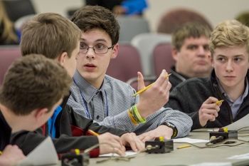 The Lone Oak Middle School team deliberates during the finals of the DOE West Kentucky Regional Middle School Science Bowl.