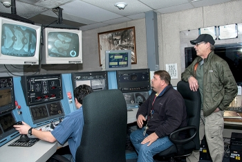 Energy Secretary Rick Perry participates in a demonstration of crane equipment at the H Canyon Chemical Separations Facility.