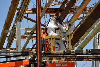 Crews deactivate the Central Neutralization Facility by disabling utilities and cutting tie lines.