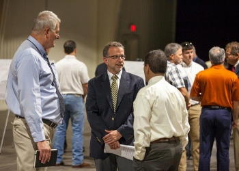 Nuclear Waste Partnership (NWP) President and Project Manager Bruce Covert talks with participants attending the Waste Isolation Pilot Plant Industry Day who learned about doing business with EM's Carlsbad Field Office and NWP.