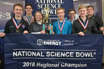 The Lone Oak Middle School winning team (left to right): Jack Perriello, Reese Bell, EM Paducah Site Lead Jennifer Woodard of EM's Portsmouth/Paducah Project Office, Isaac Reynolds, Avery Miller, Cameron Willis, and coach Daniel Rushing.