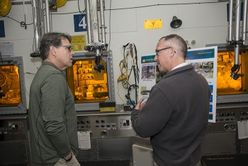 Energy Secretary Rick Perry learns more about the Mark-18a program from Bill Bates, Savannah River National Laboratory Deputy Associate Lab Director for Nuclear Materials Management Programs.