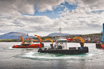 Supply chain vessels by a hilly Scottish town.