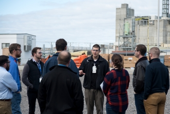 Savannah River Remediation's Carl Scherman gives a tour of the Salt Waste Processing Facility to Reaching Engineers at the Development Years participants.