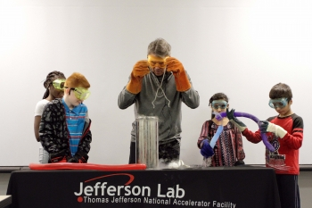 Secretary of Energy Rick Perry leads a BEAMS activity featuring liquid nitrogen. Secretary Perry and the Newport News, Va., 5th graders explored what happens to balloons and carnations when they've been cooled to -321 degrees Fahrenheit.