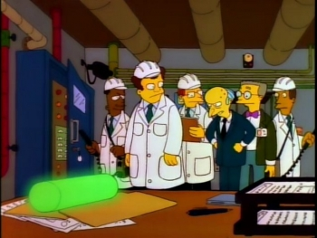 Simpsons characters look at plutonium used as a paper weight.