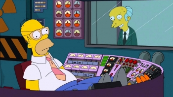 Homer Simpsons sleeps in the control room as Mr. Burns looks on