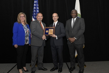 Soni Blanco, Senior Technical Program Manager for Planning and Coordination, SRS; Charles Comeau, Deputy Federal Project Director, SDU Project; DOE Under Secretary of Energy Mark Menezes; and Thomas Johnson, Associate Deputy Manager, SRO Office.