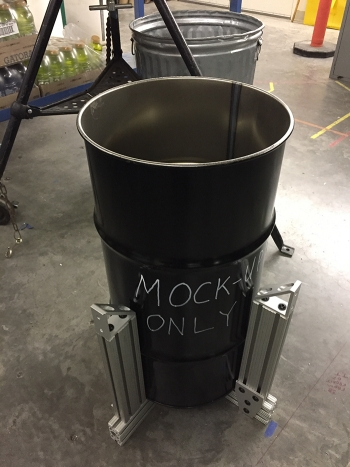 A view of a 16-gallon drum mockup with a centering device attached to allow insertion of a shielded container into a 55-gallon drum.