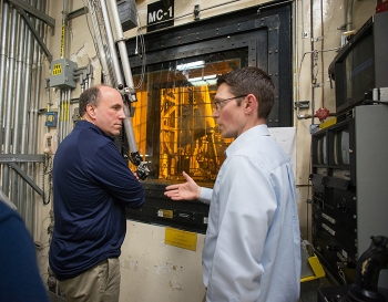 DOE Facility Representative for the Defense Waste Processing Facility Keith Sandroni (right) provides an overview of DWPF melter operations to Under Secretary for Science Paul Dabbar.